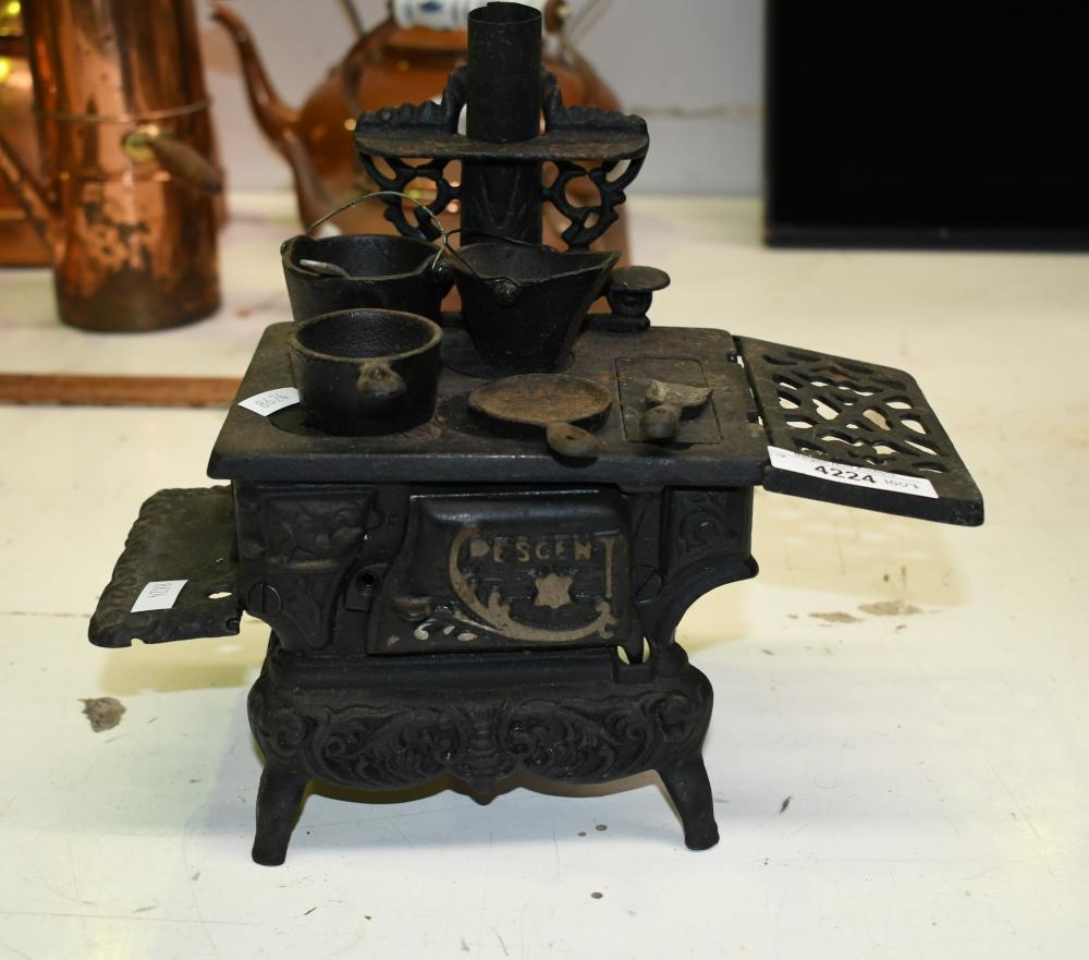 Crescent cast iron miniature stove