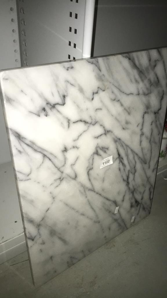 A Large White And Grey Marble Chopping Board Or Stand