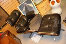 Replica Eames lounge chair and matching foot stool, note: upholstery AF