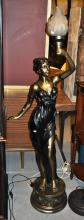 Modern floor standing lady lamp, figure of a maiden holding aloft a torch, working, 150cm T