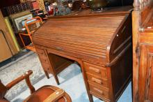 Antique oak roll top desk by Beard Watson, Sydney, roller shutter in good order, internal pigeon holes and drawers over a base fitted with pull out writing slides and various drawers, maker's details stamped to lock face, 152cm W, no key