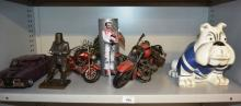 Metal work models to incl. a GTHO Falcon, 3 motor cycles, Ned Kelly figurine, Peter Brock character tin, an AUstralian pottery NRL bull dog ornament