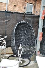 Black plastic cane weaved hanging verandah chair