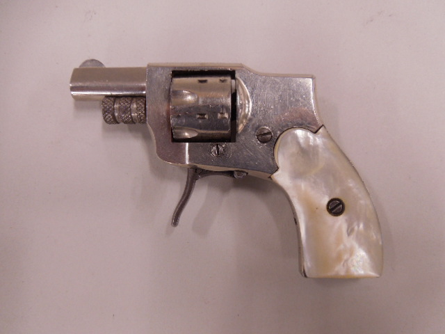 Baby Hammerless Model 1910 .22 Revolver