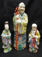 Three Chinese Famille Rose Figures of Immortals