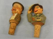 2 Carved Figural Mechanical Stoppers