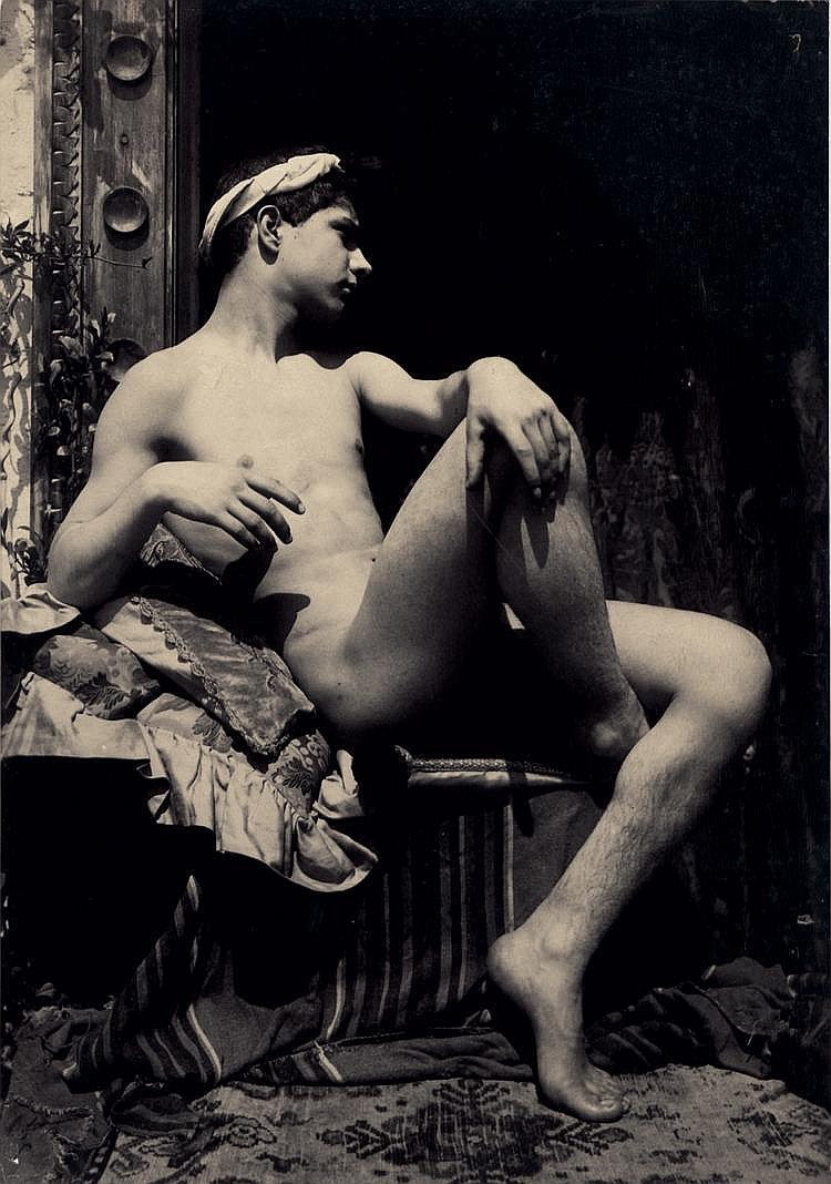 Plüschow, Guglielmo: Young nude boy seated on terrace