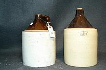 Pair of Antique Salt Glazed 1 Gallon Jugs A fine set with some minor chips present on each jug.