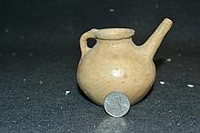 Persian Primitive Earthenware Jug A very small primitive piece thought to be from Persia 1800-800 B.C. Approx. 2