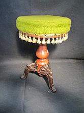 Organist Stool A beautiful stool with a walnut pedestal and cast iron feet. Adjusts up and down with a green tasseled upholstered seat.