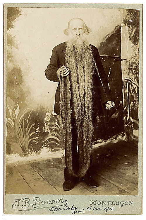 A man with a very long beard.