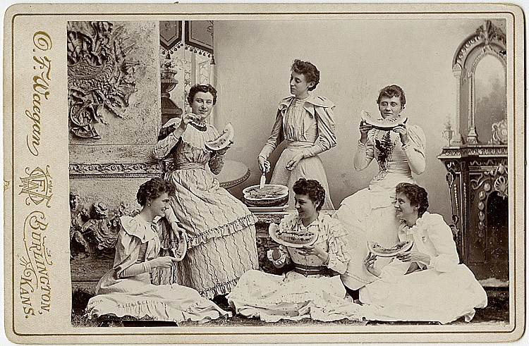 Women at a watermelon party.