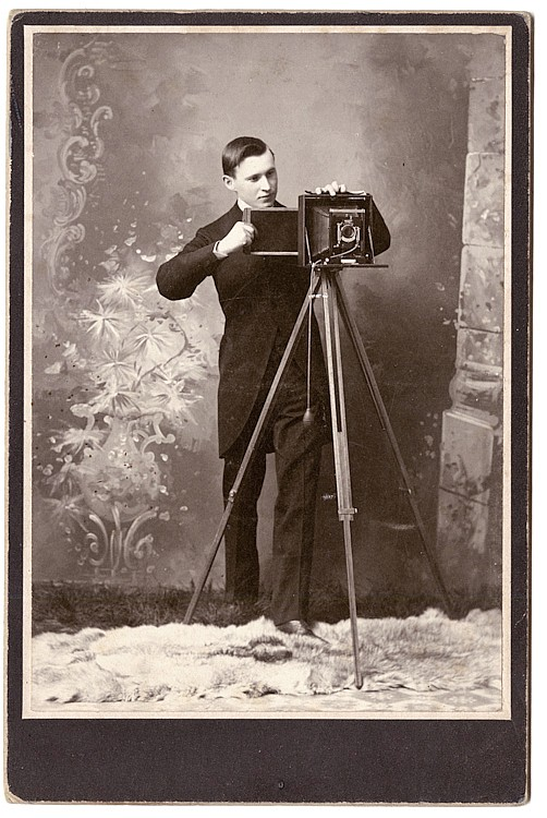 Putting the plate in the camera back. Michigan photographer