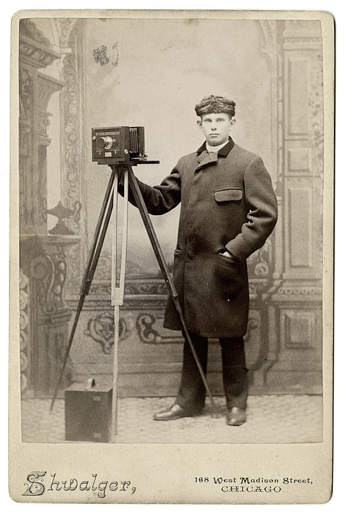 A photographer is dressed for the cold.