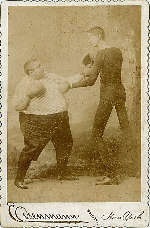 Fred Howe and George Moore in a boxing stance.