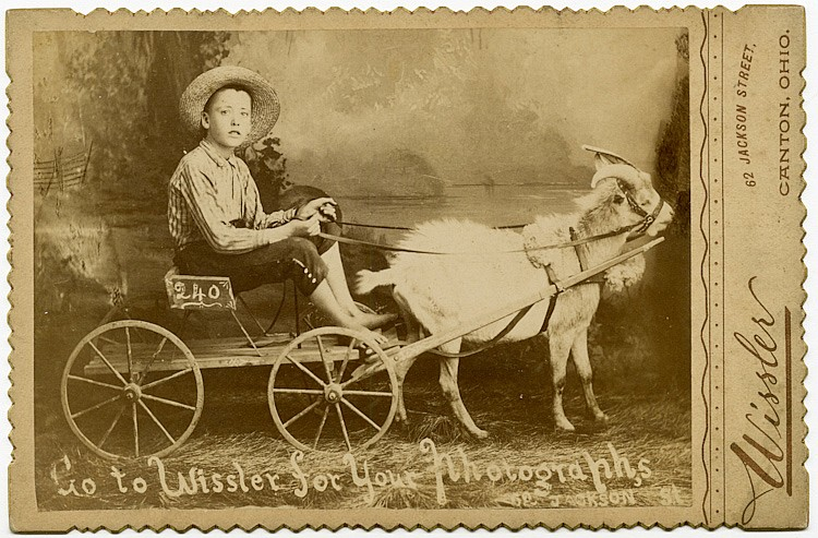 "A boy in a goat cart. ""Go to Wissler for your Photographs."""