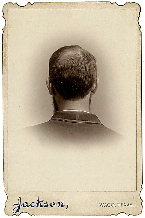 A Texas man with a bald spot, from the back.