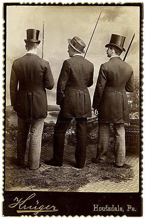 Three well-dressed gents from the back.
