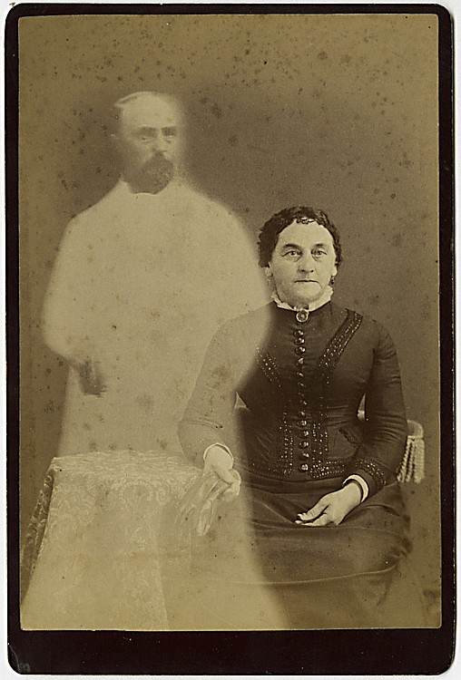A spirit photograph. A woman is visited by the spirit of her departed husband