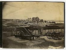 View of an encampment on the banks of a river, with cannon in the foreground.