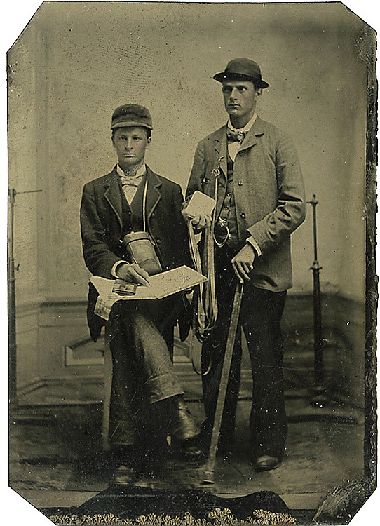 Men with measuring tools and notebook.