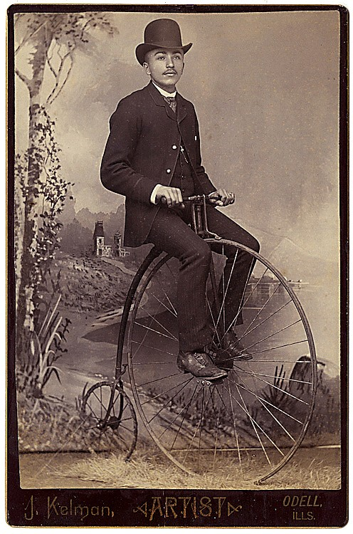 Two cabinet cards of men on high wheel bicycles.