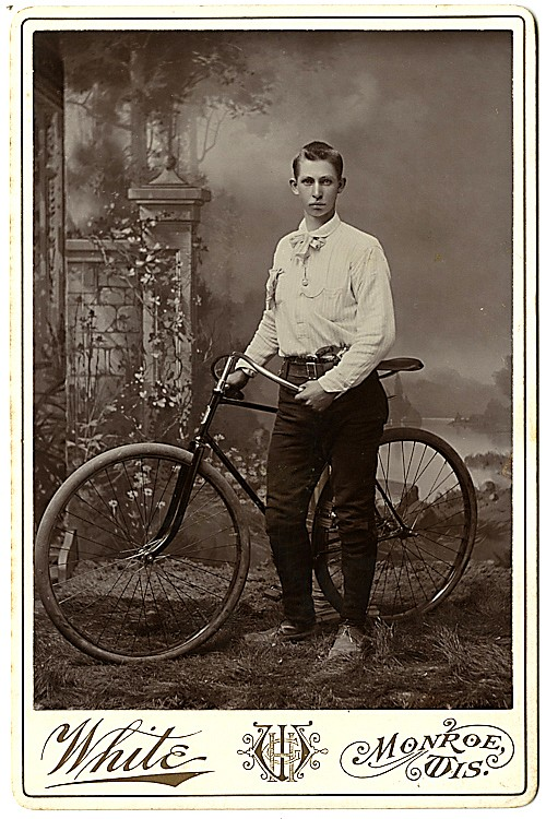 A bicycle rider with a pistol in his belt.