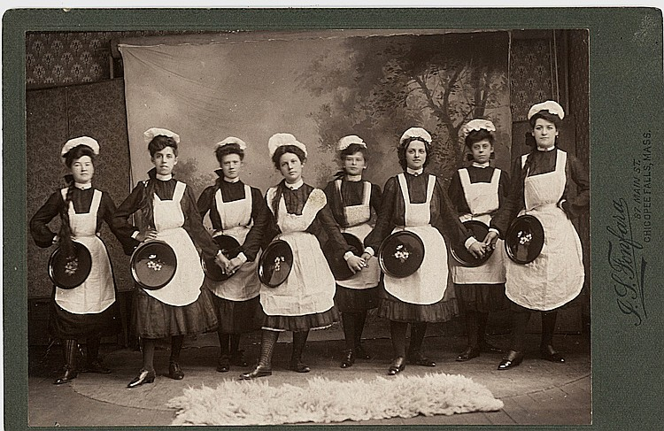 Waitresses with their trays.