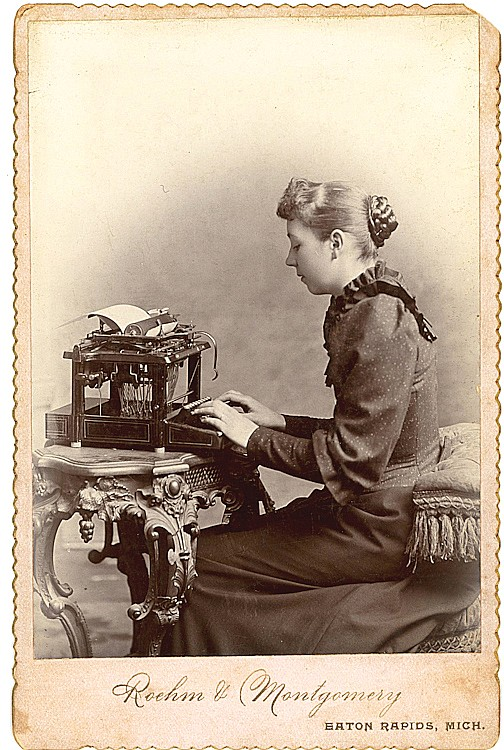 A secretary at her typewriter.