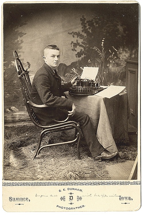 "A man with an early typewriter, identified in pen on bottom margin as ""Eugene Cass with his typewriter."""