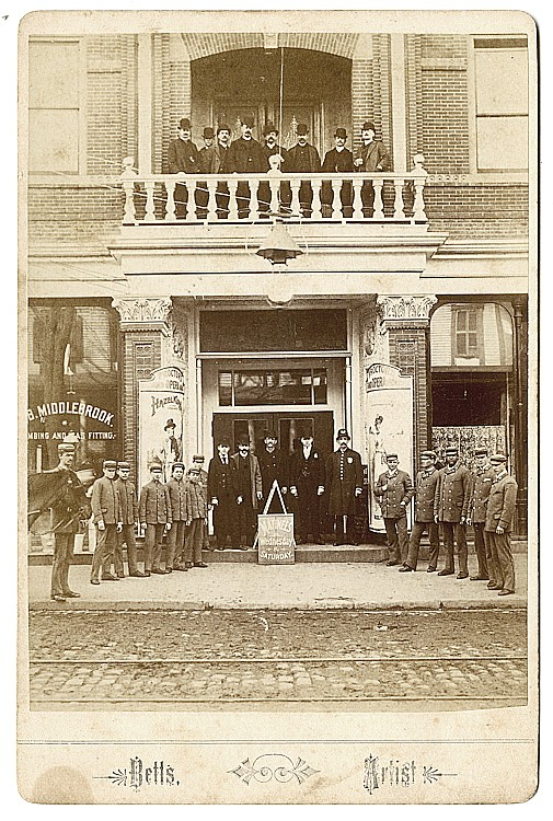 "Ushers lined up in front of Proctor's Opera House, ""Matinees Wednesday and Saturday."""