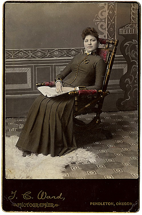 A seated woman. Cabinet card with coloring