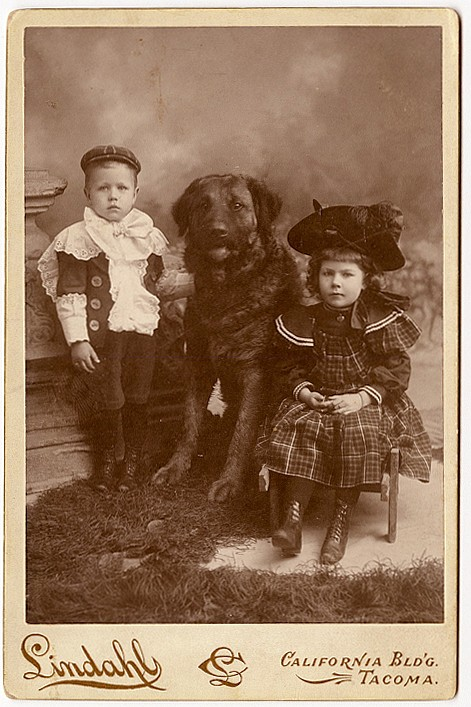 Children with a large dog.