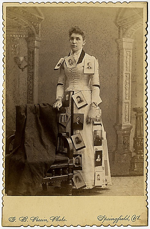 A photo advertising lady, in a dress with cabinet cards attached. .