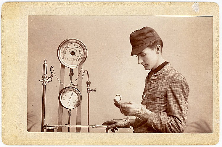 A railroad engineer, with pressure valves and meters.