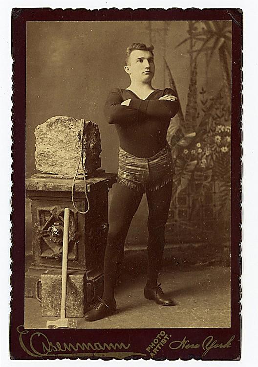Circus strong man D. A. Hall in Connellsburgh, Pennsyvania [pencil verso.]
