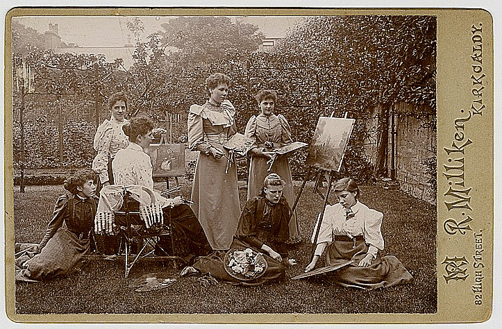 A women's painting group, outdoors.