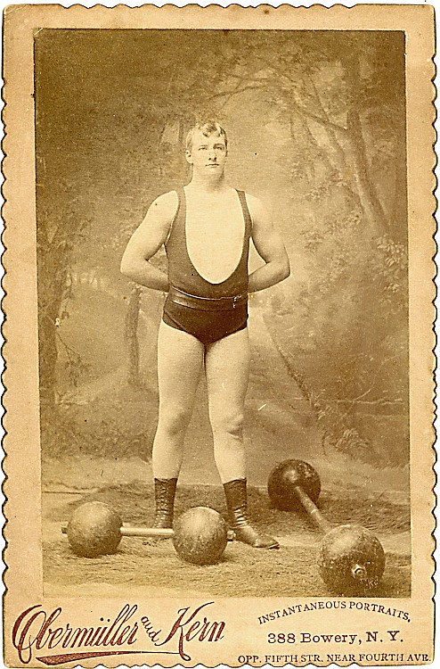 "Tullus Wright, known as ""The American Sampson,"" posed with weights."