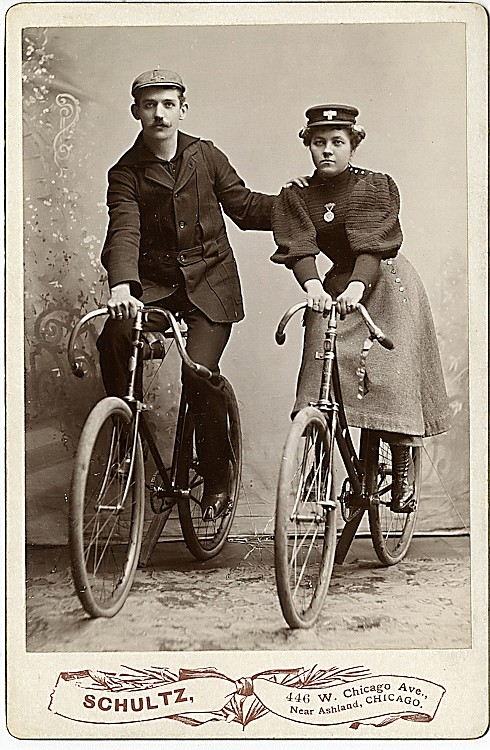 A bicycling couple.