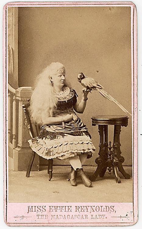"Miss Effie Reynolds ""The Madagascar Lady"" with her bird."