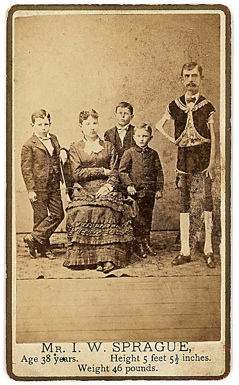 I. W. Sprague, human skeleton, posed with his wife and children.