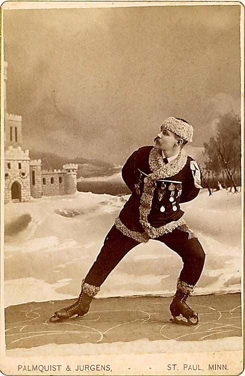 An ice skater, against a wintry backdrop.