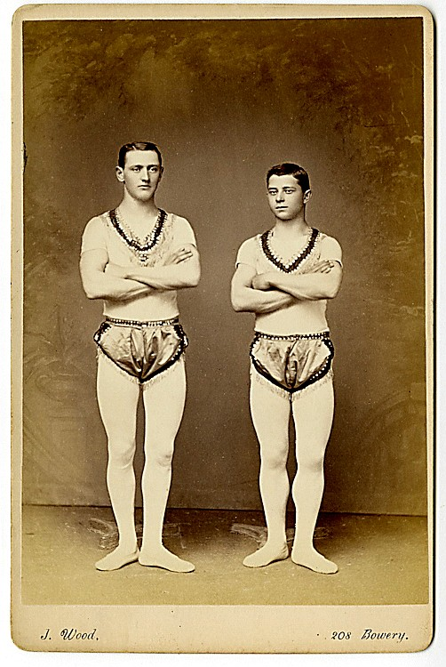 Gymnasts Cardello and Victorelli, performers on the horizontal bar.