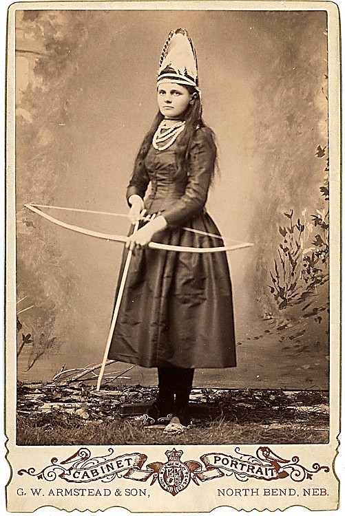 A woman archer in uniform.