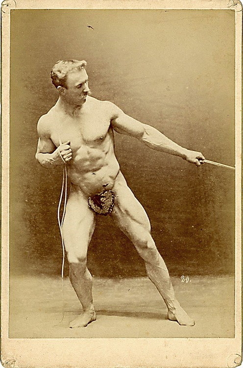 Sandow pulls on a rope, holding another rope.