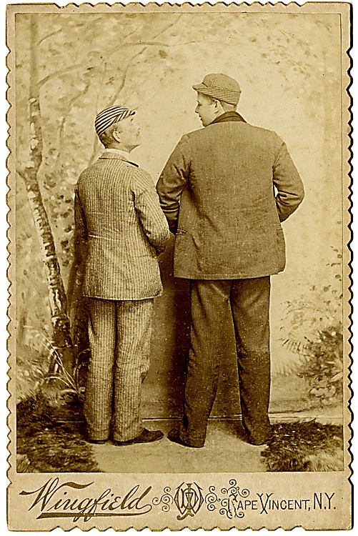 Two men from the back, looking at each other
