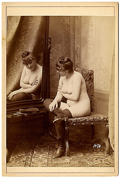 A nude reflected. The mirror has been a feature of erotic imagery long before photography