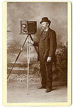 A photographer with his camera.