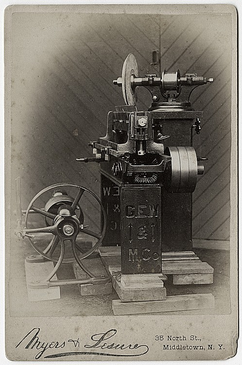 A grinding or sharpening machine.