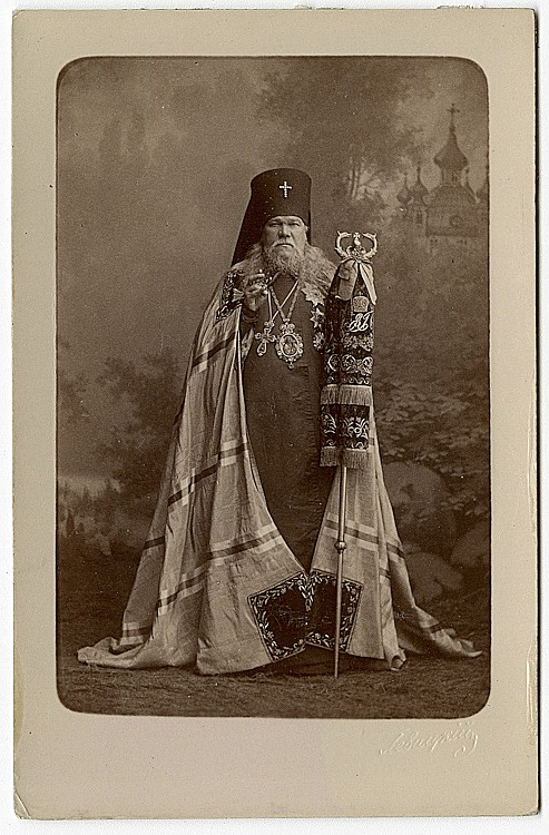 Archimandrite Leontiev in his rich garb with a misty symbolic background.